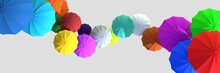 Many Multi-colored Umbrellas On A Gray Background. View From Above. Banner. Creative 3d Illustration