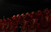 Low Angle Shot Of Rows Of Red Chairs In A Cinema Hall