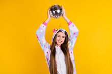 Portrait Of Attractive Cheerful Girl Wearing Animal Look Holding Disco Ball Having Fun Isolated Over Bright Yellow Color Background