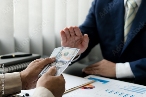Fototapeta Anti bribery and corruption concept, Business man refusing and don't receive mon