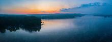 Foggy Sunrise Over Lake