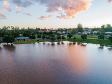 Playing Field Turned Into A Peaceful Dam With Sunset Reflections During Flood And River Backflow