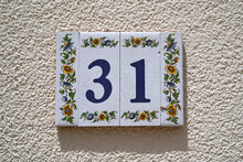 Decorated Ceramic Tiles 31 House Number On White Rough Wall