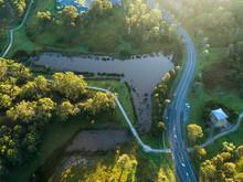 Aerial View Of Walkway Beside Flooding Dam In Park