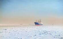 Winter Shipping. Big Cargo Ship In Ice Sea Fairway .