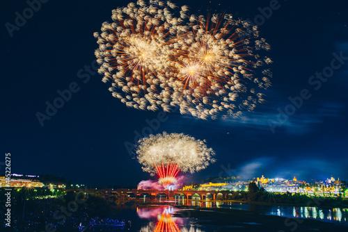 Obraz na plátně Colorful fireworks explosion on the black background