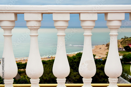 Fotomural Beauty and fashion. Balcony balusters made of lime stone
