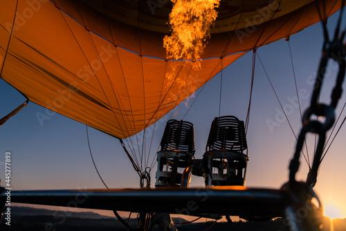 Fototapeta Detail of a hot air balloon at sunrise