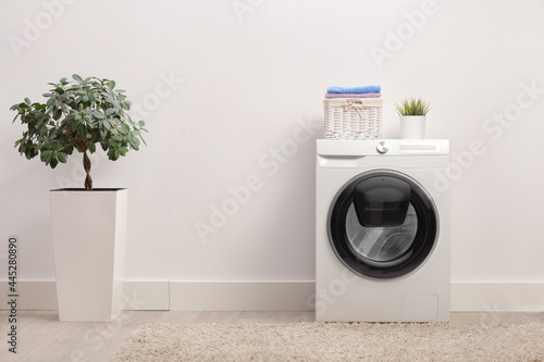 Fotografia Laundry room with a washing machine