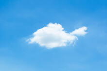 Single White Cloud That Look Like Turtle In Bright Blue Sky In Summertime.
