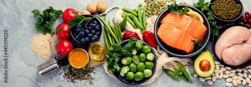 Selection of healthy food on light gray background. Clean eating concept.