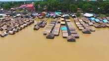 View Of Riverside Village At Wat Tham Khuha Sawan In Khong Chiam, Ubon Ratchathani, Thailand (aerial Photography)