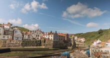 North York Moors, Heritage Coast, Staithes Time Lapse Across Harbour, Beach Headland Clip 1