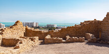 An Ancient Roman Fortress Sits On A Hill Above The Modern Resort Town Of Ein Bokek On The Dead Sea In Israel With Jordan In The Far Background