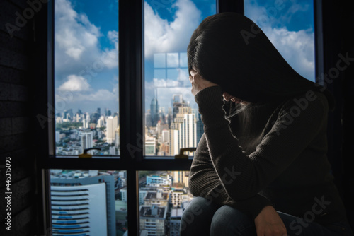 woman sit Depression Standing by window and anxiety Fototapeta