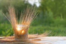 Handmade Candle Holder And Wheat Ears, Natural Summer Background. Symbol Of Lammas, Lughnasadh Pagan Holiday. Celtic Wiccan Sabbath