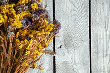 Flowers Limonium Sinuatum On A Wooden Background, Floral Background