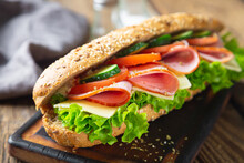 Large Sandwich With Ham, Cheese And Vegetables