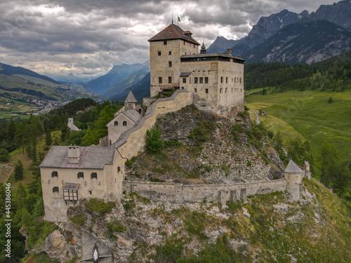 Obraz na plátně Drone view at Tarasp castle in the Swiss alps