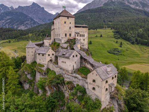Fototapeta Drone view at Tarasp castle in the Swiss alps