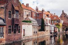 Belgium, West Flanders, Bruges, Old Town Houses Along City Canal