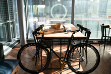 Bicycle By Table At Office Cafeteria