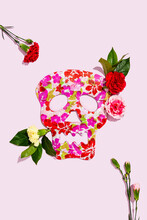 Studio Shot Of Blooming Roses And Red Skull Mask Decorated With Floral Pattern