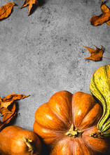 Autumnal Background With Pumpkins, Fallen Leaves And Copy Space