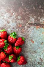 Fresh Ripe Strawberries Lying On Metal Surface