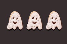 Studio Shot Of Three Glazed Ghost-shaped Chocolate Cookies