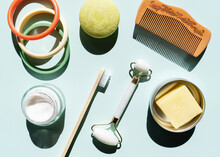 Studio Shot Of Wooden Comb, Bamboo Toothbrush, Colorful Bracelets, Organic Soap, Shampoo And Other Eco-friendly Self-care Products