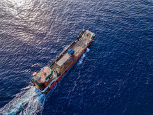 Aerial View Of Barge Transporting Single Truck