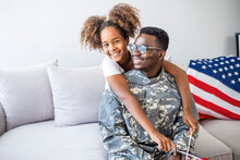 Photo Of American Soldier Playing With His Daughter At Home. Mid Adult African American Military Soldier Is Happy To See His Preschool Age Daughter. He Has Just Returned From Overseas Assignment.