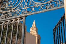 Malta, Northern Region, Mellieha, Bell Tower Of Parish Church Of Nativity Of Virgin Mary Seen Through Open Gate