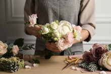 Florist Creating Beautiful Bouquet At Wooden Table Indoors, Closeup