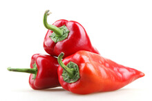 Closeup Shot Of Three Red Bell Peppers On An Isolated Background