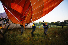 Preparing For Hot Air Balloons To Fly Over The Valley In The Early Morning