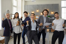 Yes We Did It. Happy Positive Triumphant Business Team Celebrating Success. Group Of Euphoric Office Workers Standing Together, Shouting Hooray, Fist Pumping After Nailing Presentation In Work Meeting