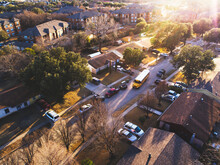 Aerial View Of Road With School Bus In Neighborhood At Sunset