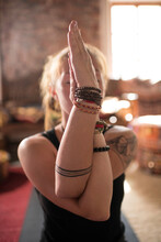 Tattooed Woman Meditating With Eagle Arms