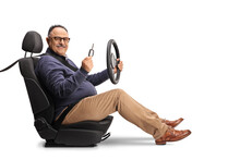 Mature Male Driver Sitting In A Car Seat, Holding A Steering Wheel And A Car Key