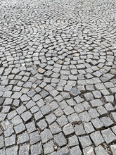 Granite Cobblestone Pavement With Circular Pattern. Abstract Street Background.