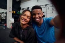 Mixed Race Friends Taking A Photo Together In The Gym. Happy African American Male And Female Taking A Selfie. High Quality Photo