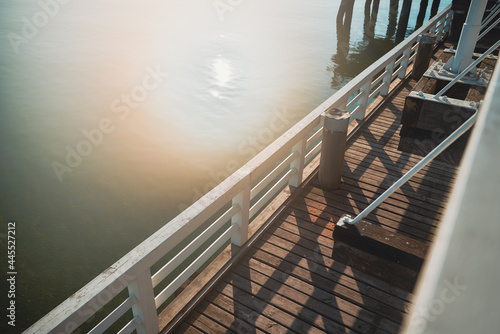Canvastavla Hazed photo of the wooden pier with white painted handrails with strong sun leak