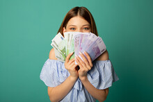 Beautiful Young Woman With Euro Money In Hands