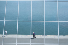 Reflection Of A Breakwater With Fishermans In Panoramic Glass Windows