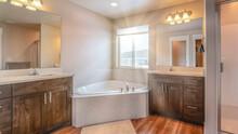 Pano Beautiful Home Bathroom With Built In Corner Bathtub Between Two Vanity Units