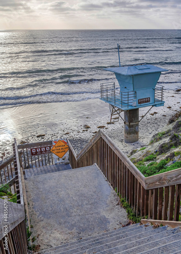 Vertical Stairs and lifeguard tower with view of ocean and sky in San Diego California