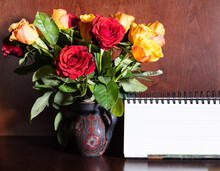 Blank Desk Calendar And Fresh Red And Yellow Roses