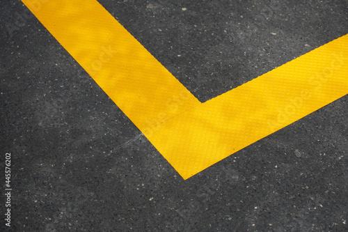 Fototapeta Closeup shot of a yellow traffic sign near gargoyle waterspout